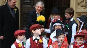 Commons Speaker John Bercow, watched by Plaid Cymru MP Elfyn Llwyd, receives daffodils from Ysgol Gymraeg Llundain pupils